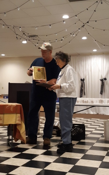 Jim Bortles, Association Vice President Presents Ruby Kimball with a plaque recognizing her induction into the Hall of Fame